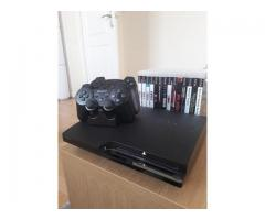 PS3 with joysticks, 17 games and 25 miniatures